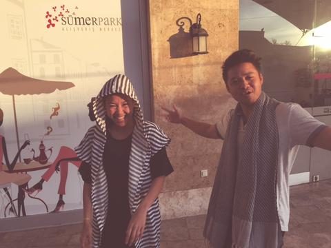 Image of author laughing with her traveling partner. Both are wearing the organic peshtemal.