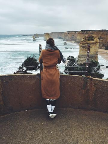 Image of the author overlooking the 12 Apostles through the wirefence.