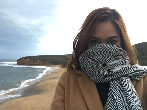 Image of the author covering her face from the cold breeze of the Indian Ocean